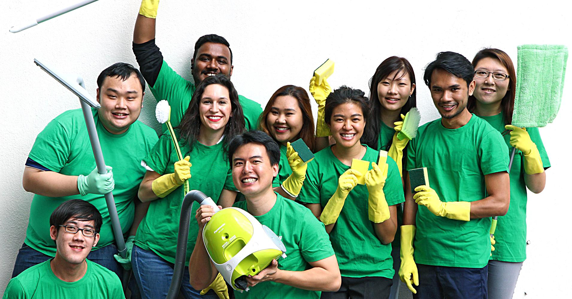 group-of-cleaners-in-green-uniform